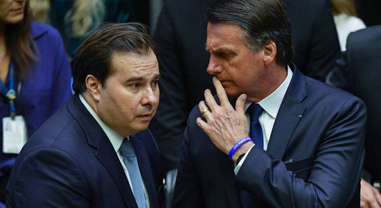 x80468033_Brazils-newly-sworn-in-President-Jair-Bolsonaro-R-talks-to-Brazilian-Lower-House-President.jpg.pagespeed.ic.pQm5t575Kf
